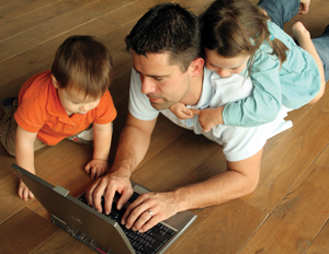 Dad and Kids with Laptop on Floor_web
